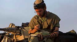 Reuters-Israeli-soldier-praying-photog-Siegfried-Modola